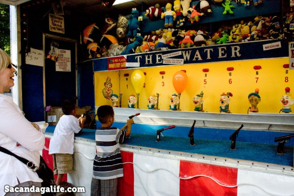 Little boys playing a carnival game