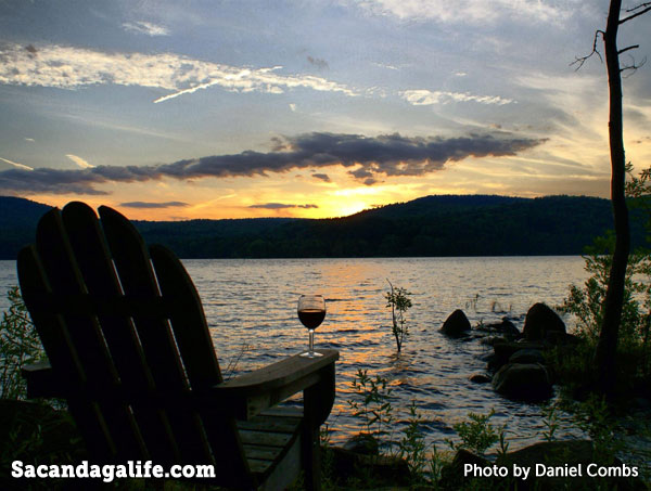 Sunset on the Great Sacandaga Lake with Adirondack chair and glass of wine